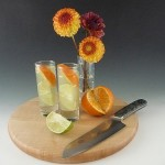 Cordials by Rolf Glass, cutting board by Whol Woodworks and Damascus and marble knife by Santa Fe Stoneworks.
