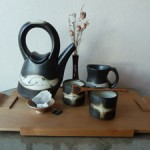 Teapot, cups and mug by Loren Lukens, Tray from John Taylor & vase from Ennis Mountain