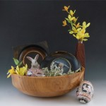 Artistic Easter Basket includes paintings from Rebecca Luncan,and Ukrainian eggs from John Anderson in aYew bol by Earl McNeil.