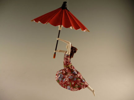 Umbrella Figure Handmade with Sealed Paper and Fabric. Measures 9 Inches Long and 5 Inches Wide.
